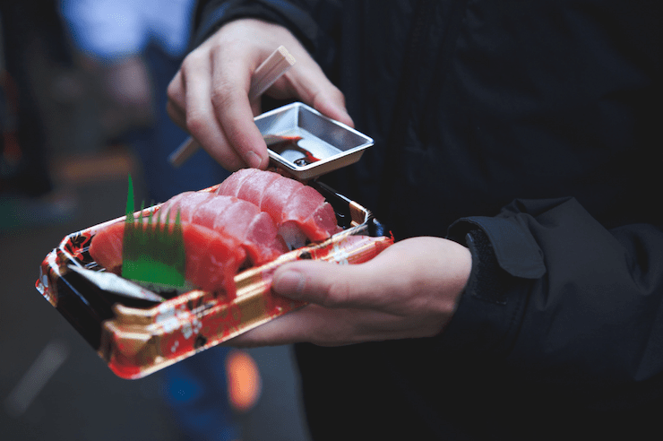 Person holding Sushi